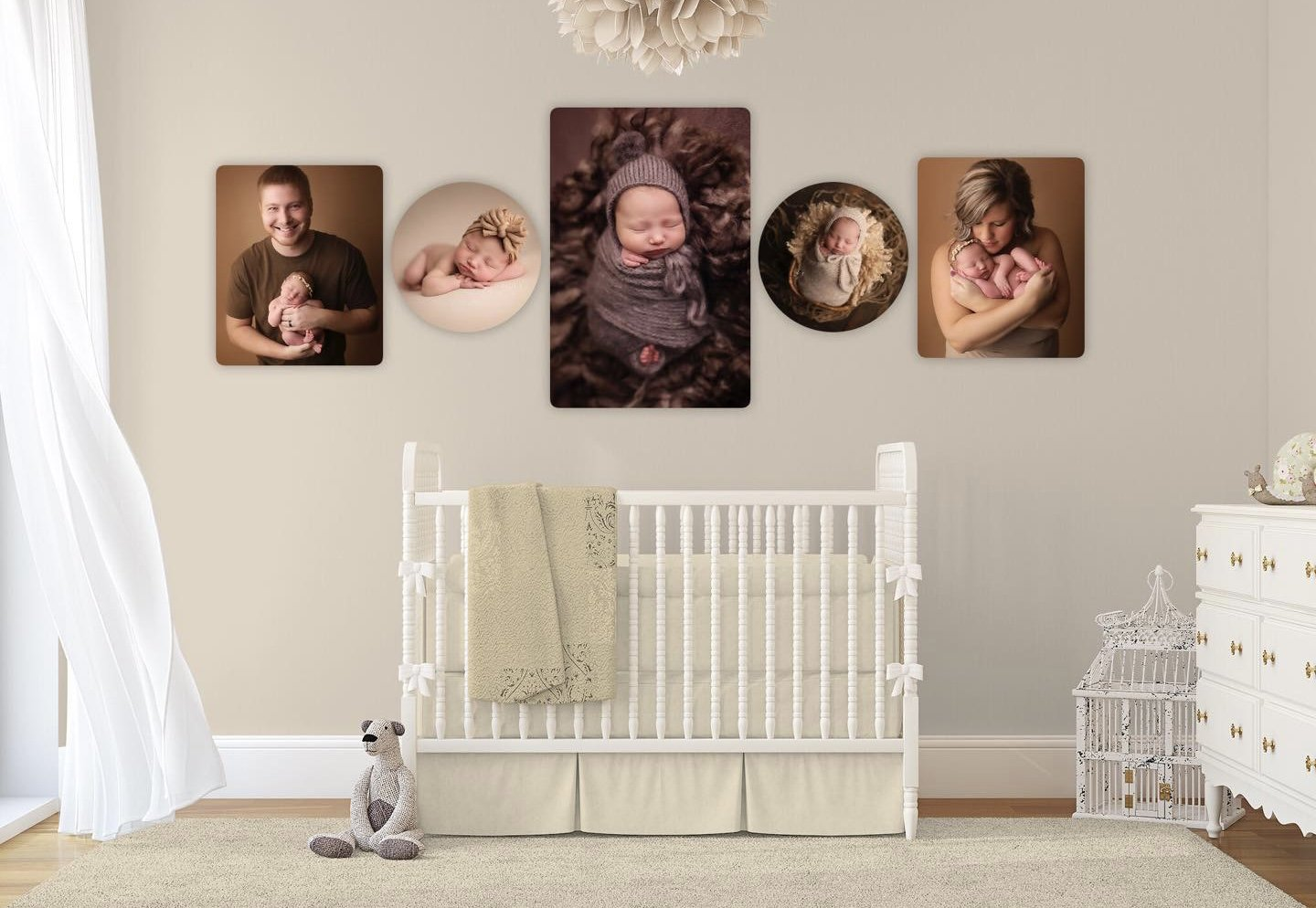 Nursery with newborn images on wall
