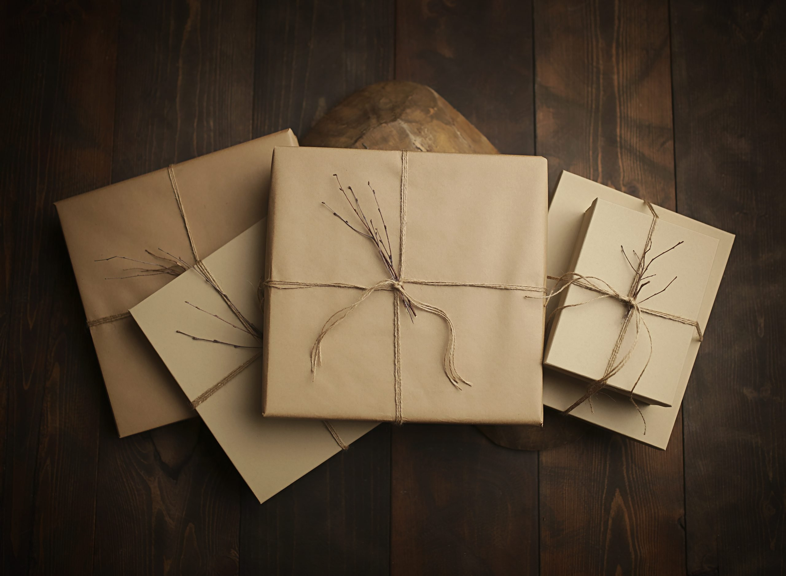 heirlooms/albums packaged in neutral paper and twine